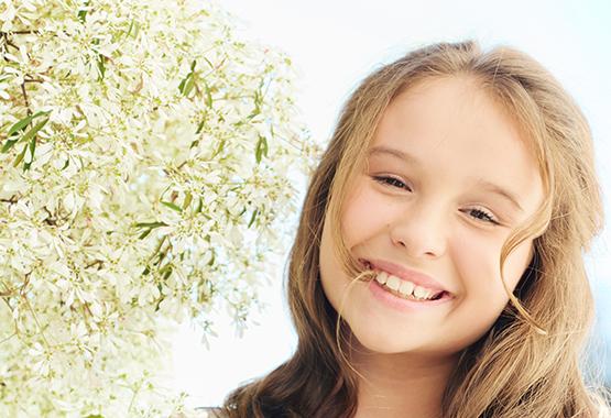 Девочка с красивой улыбкой